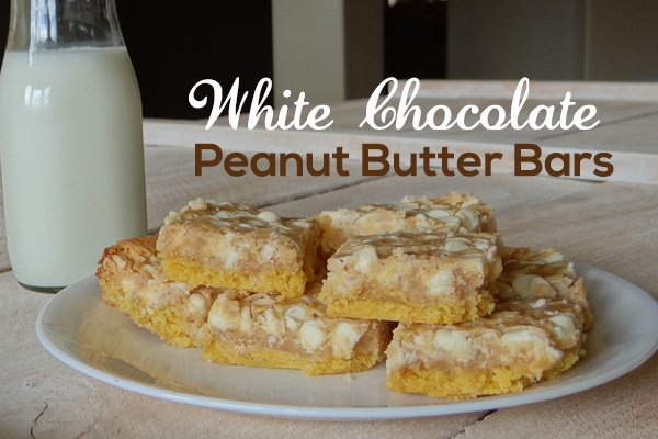 bottle of milk next to white chocolate peanut butter bars