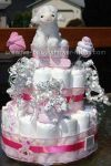 white lamb diaper cake with pink and white sock roses