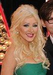 smiling christina aguilera wearing teal dress