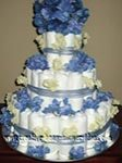 3 tier diaper cake with blue and cream flowers