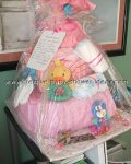 pink blanket with duck rattle diaper cake