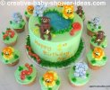 cute light green jungle baby shower cake and cupcakes with fondant jungle animals