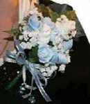 blue and white baby sock corsage with sock roses white flowers and mini blue pacifiers