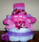 pink and purple girl diaper cake with a cute onesie that says I can't talk yet but I have attitued