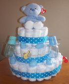 white and blue polka dots bear diaper cake
