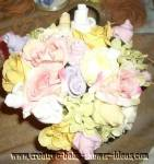 pastel baby sock rose and clothing bouquet