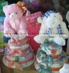 blue and pink twin diaper cakes