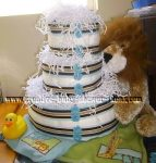 lion nappy cake with stripes and buttons