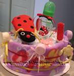 red ladybug diaper cake centerpiece