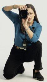 photographer looking through camera