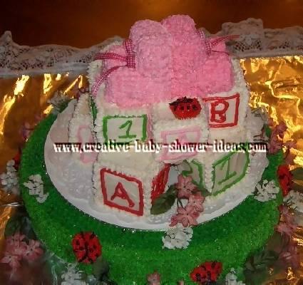 ladybug and booties baby blocks cake