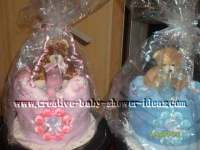 pink and blue diaper cakes for a baby shower