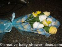 yellow and white baby sock roses