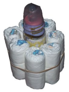 baby bottle with 1st row of diapers around it for diaper cake