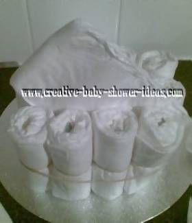 nappies being placed into diaper cake craft