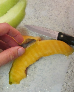 cut skin off back of cantaloupe