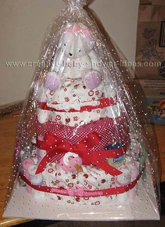 finised and wrapped red and white ladybug bunny diaper cake