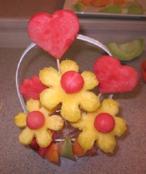 placing skewers into fruit bouquet