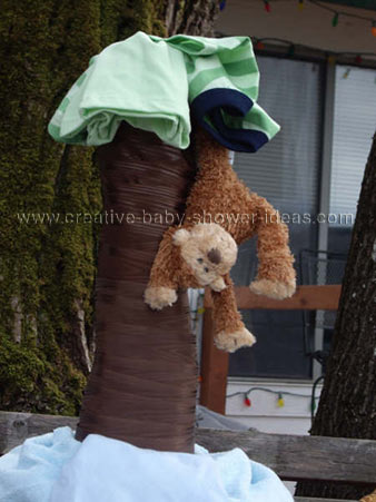 closeup of diaper cake showing monkey hanging from tree