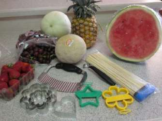 fruit and supplies to make edible bouquet
