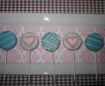 pink heart and blue plaid chocolate covered oreo lollipops