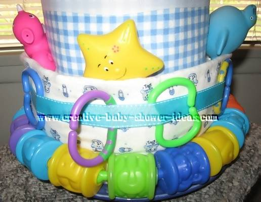 closeup of bottom layer nappy cake with linking toys