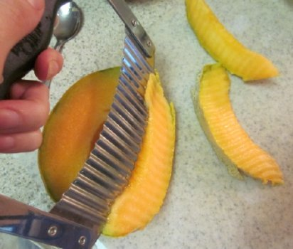 cutting cantaloupe spears for fruit bouquet