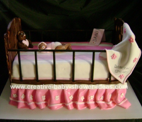side view of crib baby cake with blanket