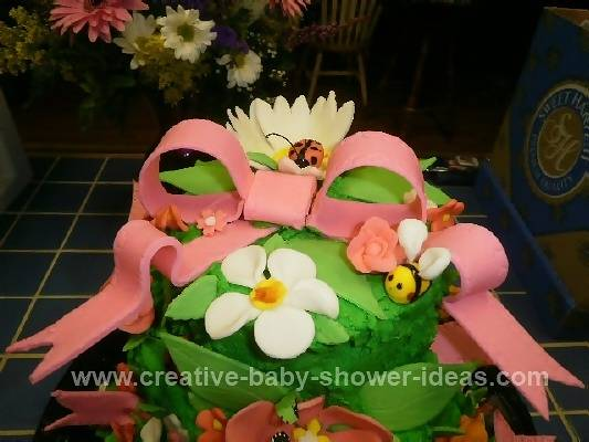 Closeup of Green Baby Bug Cake with Flowers