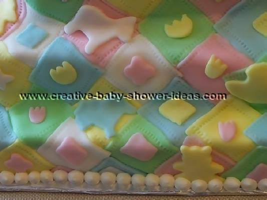 closeup of colorful quilt blocks baby cake