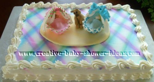pink and blue plaid baby shower bassinet cake
