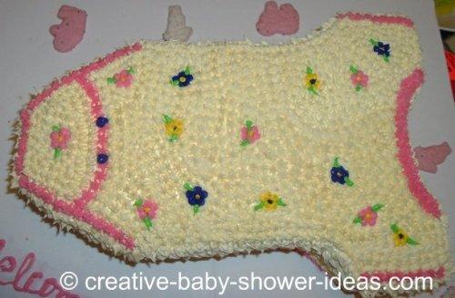 pink and cream flowers onesie baby shower cake