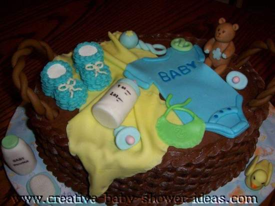 chocolate baby basket cake with baby clothes