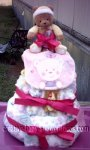 yellow bear diaper cake with pink accents