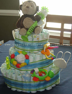 side view of green and blue striped monkey diapers cake