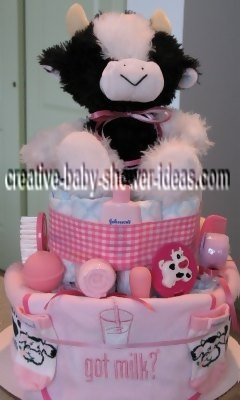 white and white got milk cow diaper cake