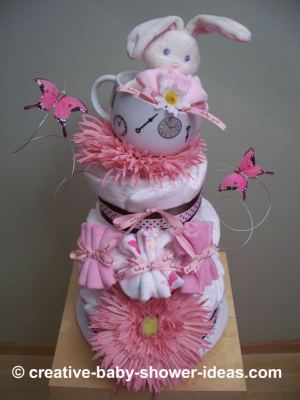 alice in wonderland diaper cake with gerber daisies