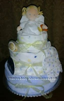 3 tier angel diaper cake wrapped in blue and white blankets