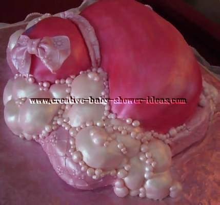 back of pink duck cake showing bubbles and pink pillow