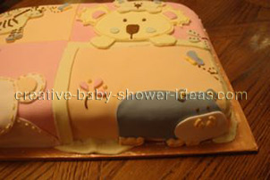 closeup of hippo animal on quilt blocks cake