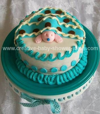teal and white boy baby blanket cake