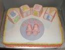 pink shoes and blocks baby cake