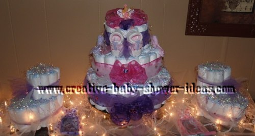 baby shower display with 3 bootie cakes and tulle and christmas light decorations