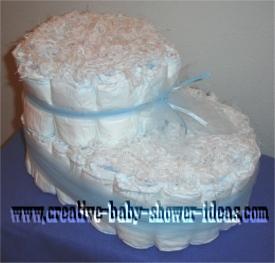 کیک پوشک مناسب جشن قدم baby bootie diaper cake
