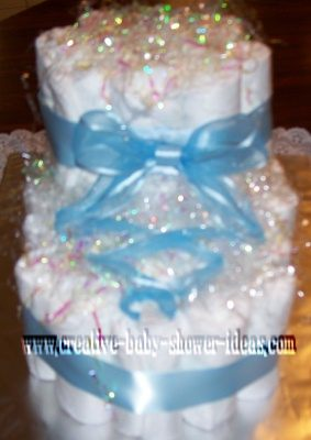 bootie diaper cake with blue satin ribbon tied like a shoe