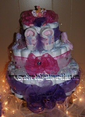 3 tier diaper cake with pink and purple organza bows and ribbon