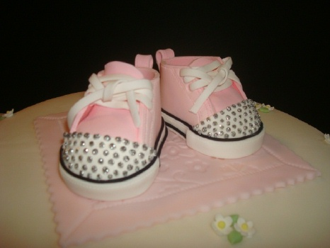 closeup of pink and baby sneakers with edible rhinestones