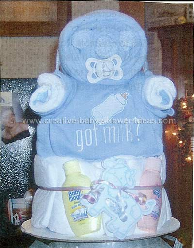 blue and white diaper cake baby with pacifier