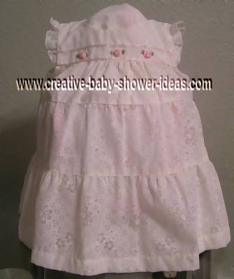 white dress with pink roses covering diaper cake