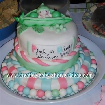 pink blue and green pea in a pod baby cake that says pink or blue we love you!